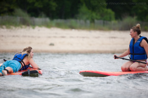 Maddie Bauer, left, and Emily Dann talk on their paddleboards at the York River in Yorktown, Va., on Thursday, July 2, 2015. In addition to kayaks and paddleboards, Patriot Tours and Provisions rents canoes, bikes, and Segways.