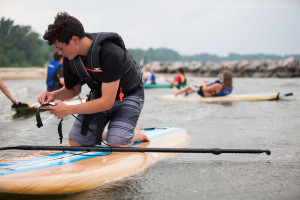 Carter Herman adjusts the ankle strap on his paddleboard at the York River in Yorktown, Va., on Thursday, July 2, 2015. In addition to kayaks and paddleboards, Patriot Tours and Provisions rents canoes, bikes, and Segways.